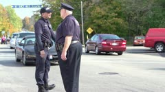 Police directing traffic hand held Stock Footage