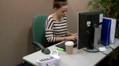 Teen office worker answering a call Stock Footage