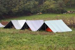 Boy scout tents mounted on the grass Stock Photos