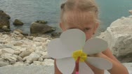 Child Playing with Windmill on the Beach, Little Girl Plays with Windmill Stock Footage