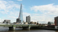 Train on bridge with The Shard London - stock footage