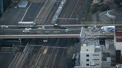 Tokyo Railway, Japan, Regional Train Passing, Speed Train, Car Traffic, Highway Stock Footage