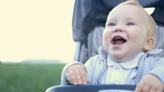 Smilling baby sitting outdoors Stock Footage