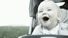 Smilling baby sitting outdoors - stock footage