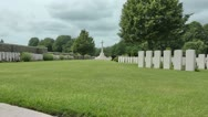 Stock Video Footage of Zoom - Cross of sacrifice, Bedford House cemetery Great War battlefield, Ypres