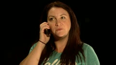 Woman gets a good news phone call Stock Footage