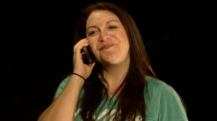 Woman gets funny gossip during phone call Stock Footage