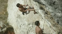 Climbers on a rock - stock footage