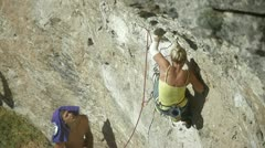 The woman - a climber and belayer Stock Footage