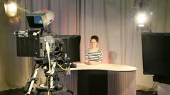 Female teenage presenter in television studio 2 Stock Footage