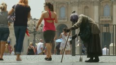 A begger outside St Peters, Rome SLOW MOTION Stock Footage