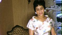 Black WOMAN PARTY DRESS African American 1970s Vintage Film Home Movie 5285 Stock Footage