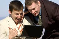 Two excited businessmen with laptop Stock Photos