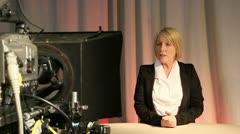 Mature female presenter in television studio 1 Stock Footage