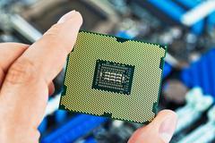 CPU in hand - stock photo