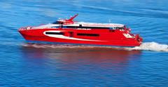 Red yacht with motion blur - stock photo