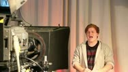 Male teen presenter in television studio 1 Stock Footage