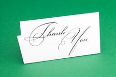 Card signed thank you on green background Stock Photos