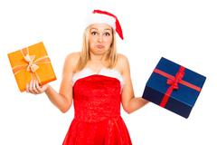 funny indecisive santa female with christmas gifts - stock photo