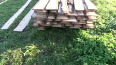 New sawn timber on grass Stock Footage
