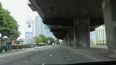 Driving under flyover M4 motorway into west London Stock Footage