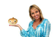 beautiful blonde holding an anthropomorphic onion - stock photo