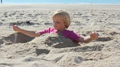 Child plays at the beach Stock Footage