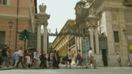 Tourists walk past Vatican entrance Stock Footage