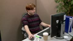 Bored teenager in office Stock Footage