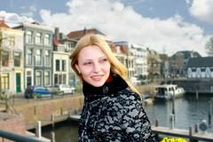 Girl on the waterfront in the dutch town of gorinchem. netherlands Stock Photos