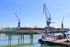 Industrial landscape. cranes in shipyard Stock Photos