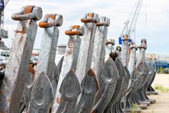 several new anchors in the shipyard - stock photo