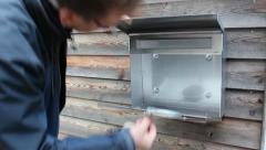 Man opens empty letterbox Stock Footage
