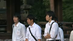 Schoolkids walking near the Yasaka Shrine Stock Footage