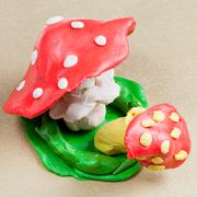Two plasticine fly agaric Stock Photos