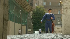 A Swiss guard salutes a Monk at the Vatican Stock Footage