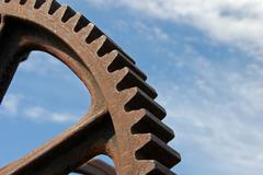 Stock Photo of old industrial gear segment against the blue sky