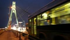 Road traffic on the bridge in nighttime (with stereo sound) - stock footage