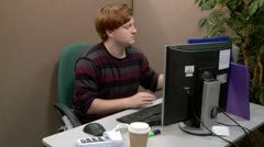 Teen office worker checking files Stock Footage
