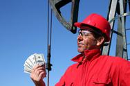 Oil Worker With Dirty Face Holding US Dollar Bills Stock Photos