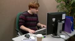 Teen office worker struggling to find information in files Stock Footage
