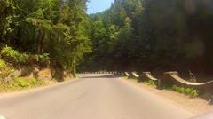 Driving through beautiful mountainous terrein during summer season. Stock Footage