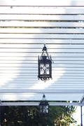 decorative lantern hanging in the arbor - stock photo
