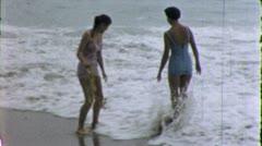 BEST FRIENDS Wade in Waves Women Ocean Beach 1950s Vintage Film Home Movie 5311 Stock Footage