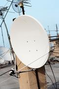Satellite dish with sky on roof Stock Photos