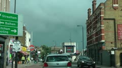 Driving through London, past Tooting Bec underground station Stock Footage