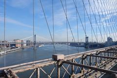 manhattan bridge and east river - stock photo