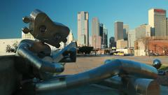 "Dallas Skyline with Public Art ""Guitar Man"" w dart Bus - stock footage"