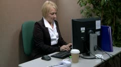 Mature office worker messing about at work Stock Footage