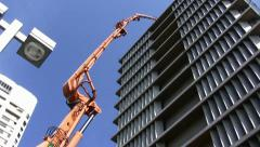 A huge crane brings concrete to the top of city hall, Tel Aviv, Israel Stock Footage